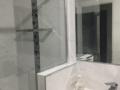 Semi-frameless/hob wall